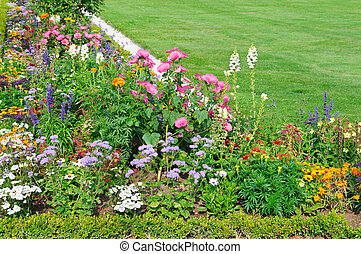flower bed and green lawn