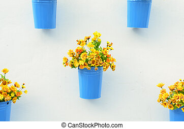 Beautiful flower in pots on white wall