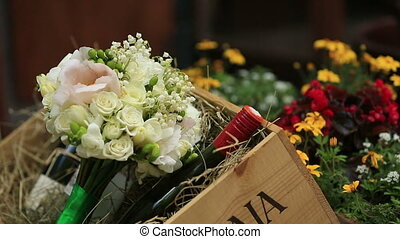Beautiful flowers and bottles of red wine close up