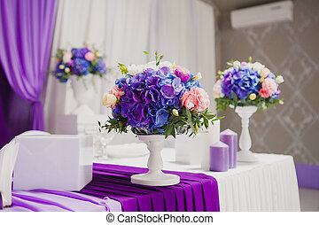 Beautiful flowers and candles on table in wedding day....
