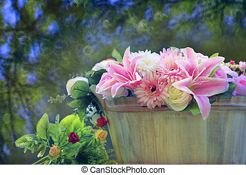 beautiful flowers bouquet arranged in wood bucket with copy...