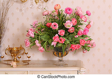 beautiful flowers in a vase on a white table