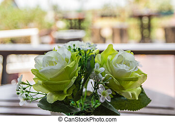 Beautiful flowers on wooden table brown.