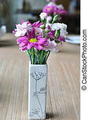 Beautiful flowers on wooden table.