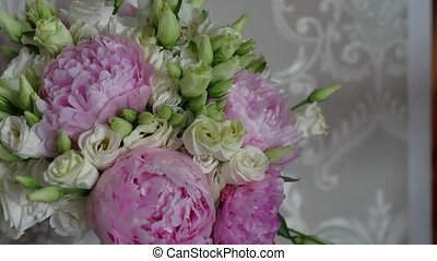 Beautiful flowers stand in a room in a vase lifestyle
