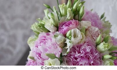 Beautiful flowers stand in a room in a lifestyle vase