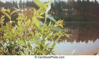 Beautiful forest landscape of the lake and plants. Two man fishing in the rubber boat, resting together on the nature.