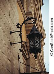 beautiful forged lantern on the wall