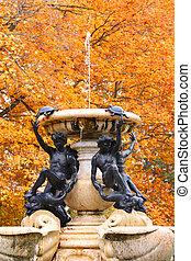 Beautiful fountain in autumn time