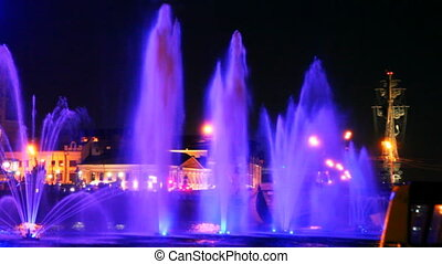 beautiful fountains illuminated with violet on Moscow River