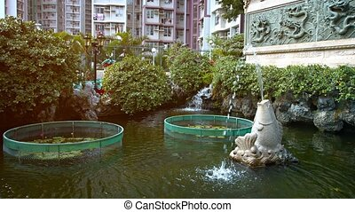 Beautiful Fountains in a Buddhist Temple Garden Pond