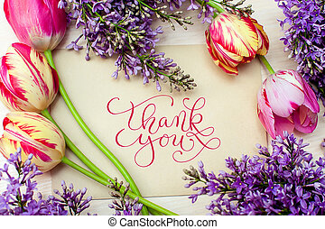 Beautiful frame of lilacs and tulips for greeting card with words thank you