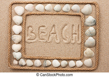 Beautiful frame of rope and seashells on the sand with...