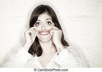 Beautiful Freak - Portrait of a beautiful young woman making...