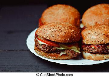 Beautiful Fresh burger a closeup on the dark background