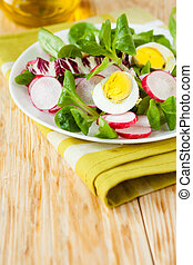 beautiful fresh salad with egg and vegetables
