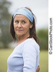 Beautiful friendly happy mature woman outdoor - Portrait...
