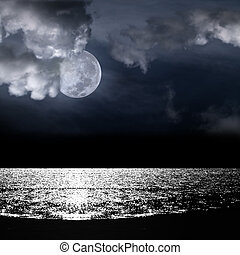 Beautiful full moon behind cloudy