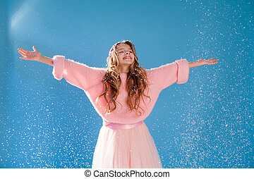 Beautiful fun fashionable girl in a winter snow cap