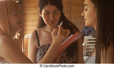 beautiful fun girls dye their eyebrows and talking among...