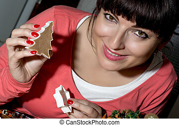 Beautiful funny woman cutting gingerbread shapes from dough