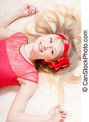 beautiful funny young blond woman pinup girl happy smiling & looking at camera on white background closeup portrait