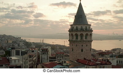 Beautiful Galata Tower at Sunrise in the Heart of Istanbul City in Yellow light, Aerial View from above
