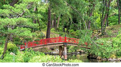 Beautiful garden in Japan with red bridge