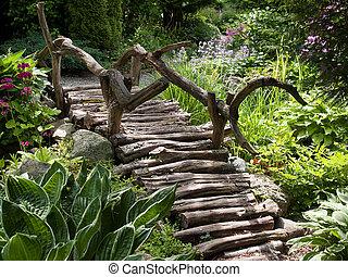 Beautiful garden landscape wooden foot bridge