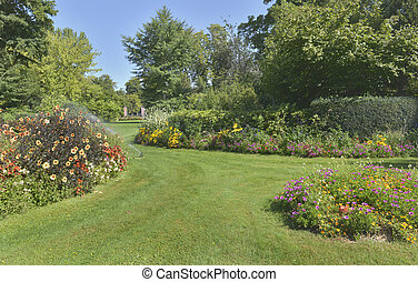beautiful garden landscaped  with colorful  flowerbed blooming in summer