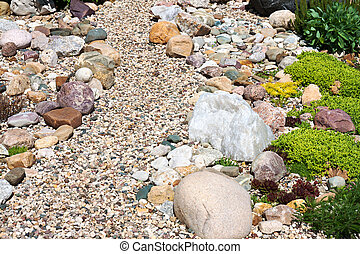garden with design from garden plants and stones