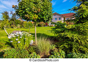 Beautiful Garden with house under beautiful sky