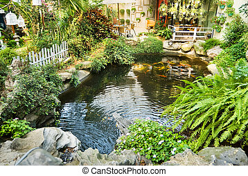 Beautiful garden with Japanese carps in the pool