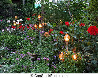 Beautiful garden with lamps