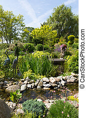 Beautiful garden with pond and several ornaments