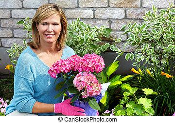 Beautiful gardening woman.