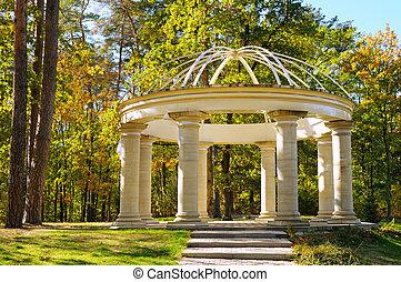 beautiful gazebo in autumn park