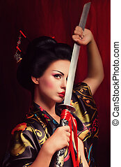 geisha in kimono with samurai sword - Beautiful geisha in ...