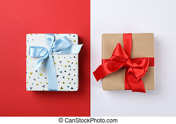 Beautiful gift boxes on two tone background, top view