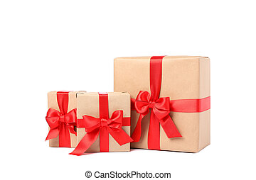 Beautiful gift boxes with red bow isolated on white background