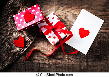 Beautiful Gift boxex with hearts, red bow ribbon and paper...
