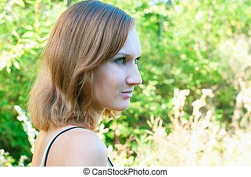 girl against summer landscape