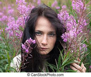 beautiful girl among the flowers - Portrait of beautiful...