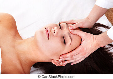 Beautiful young womanl and beautician. Facial massage.