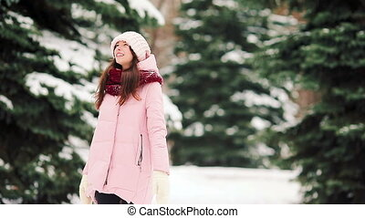 Beautiful girl at snow weather outdoors on beautiful winter day