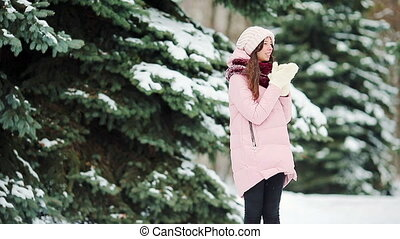 Beautiful girl at snow weather outdoors on winter day