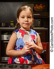 Beautiful girl baking cookies