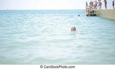 beautiful girl bathing in the sea.