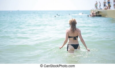 beautiful girl bathing in the sea.