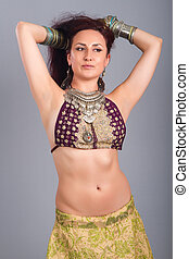 Beautiful girl belly dance movement